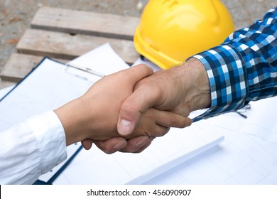 Handshake deal at construction site