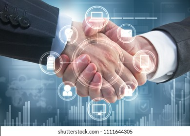 Handshake with digital business interface. Teamwork and technology concept. Double exposure