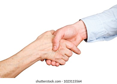Handshake of elderly woman, wrinkled hand w/ clearly visible veins & young man in blue shirt. Old lady & male nurse doctor making deal in nursing home. Isolated white background, close up, copy space.
