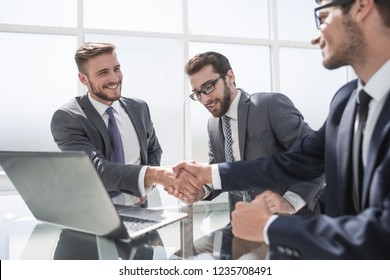 handshake employees at the Desk