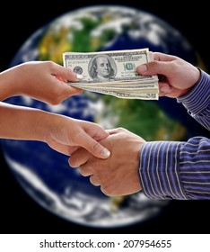 Handshake exchange on earth background. Element of this image furnished by NASA