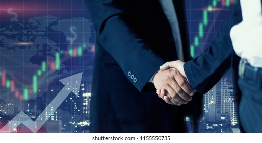 Handshake - Hand holding on trading forex data information displayed on a stock exchange interface - Finance concept
