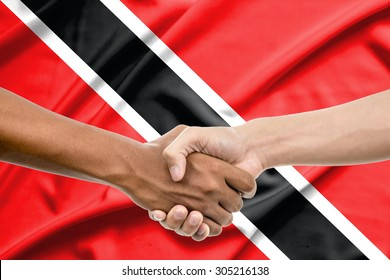 Handshake - Hand holding on Trinidad and Tobago flag background
