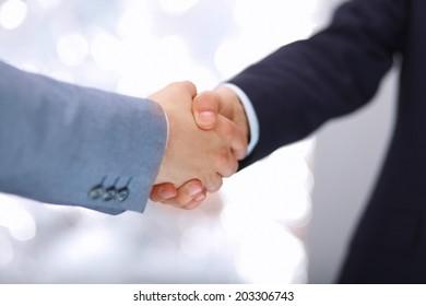 Handshake - Hand holding on white