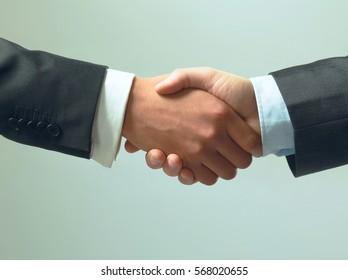 handshake isolated on grey background