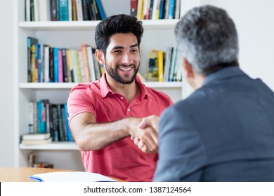Handshake of latin american male apprentice after job interview with businessman at office