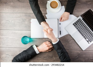 Handshake - Man and woman Hand holding. Top view for top managers