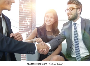 handshake Manager and the client at a meeting in the office lobb