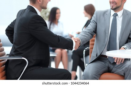 handshake Manager and the client in the office.