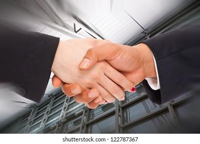 Handshake men and women in business background.