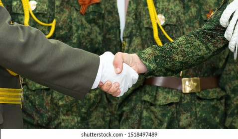 Handshake of a military man in a white glove