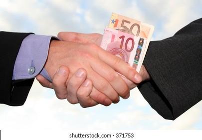 a handshake with money