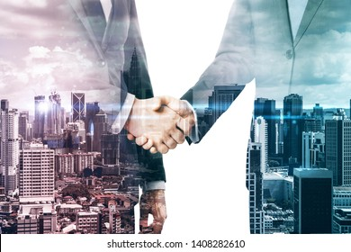 Handshake on abstract city background. Teamwork and partnership concept. Multiexposure