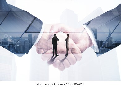 Handshake on abstract office background with people and sunlight. Finance and teamwork concept. Double exposure