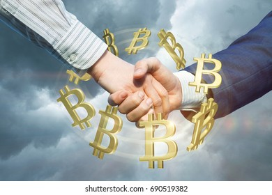 Handshake on the background of the turnover bitcons.Concept design.