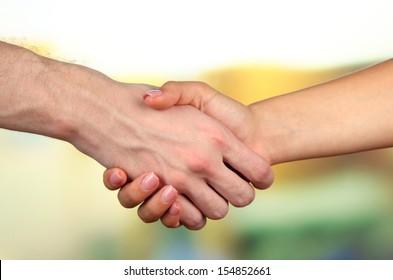 Handshake on bright background