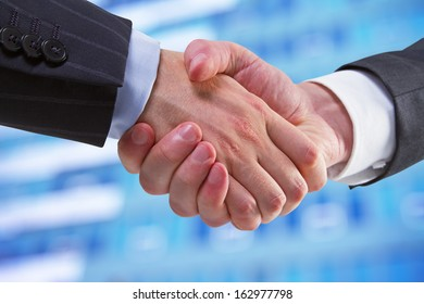 handshake on a building background