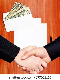 Handshake on Envelope with a Money and Empty Paper