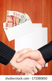 Handshake on Envelope with a Russian Money and Empty Paper