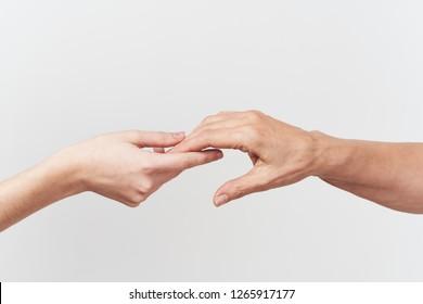 handshake on a gray isolated background, phalanx fingers