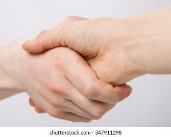 Handshake on grey background
