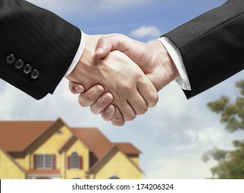 handshake on a house background