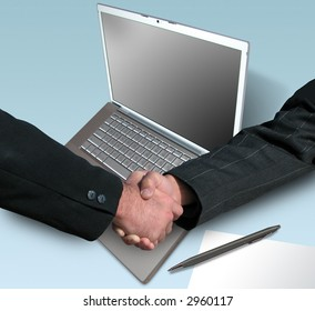 handshake over paper and pen with a laptop in the background