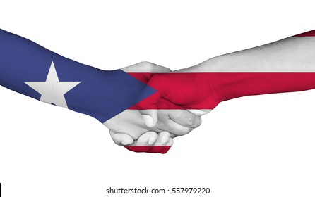 Handshake of Puerto Rico flag painted on hands