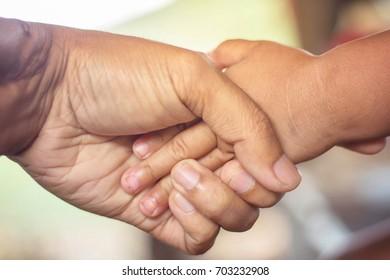 Handshake showing background concern blurred