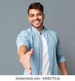 Handshake. Smiling Arab Guy Stretching Hand For Greeting. Free Space