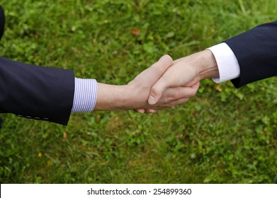 Handshake of two businessmen in suits