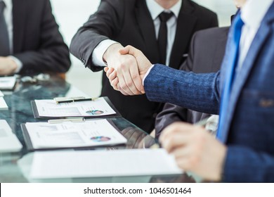 handshake of two lawyers after discussing the terms of a financial contract