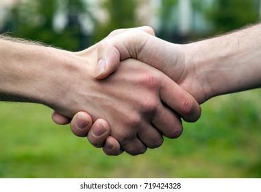 handshake of two men close up