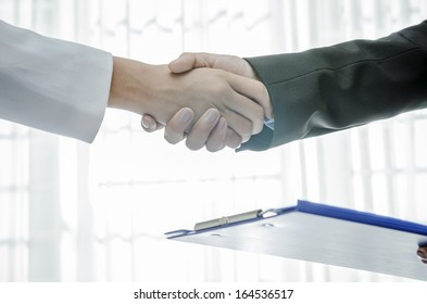 Handshaking of business people for a deal