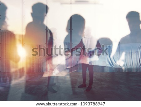 Handshaking business person in office. concept of teamwork and partnership. double exposure