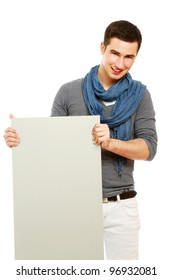 A handsoma man holding a blank, isolated on white background