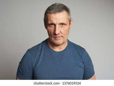 Handsome 50 years man isolated on grey background