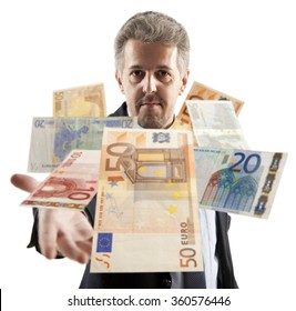 Handsome adult businessman throwing euro