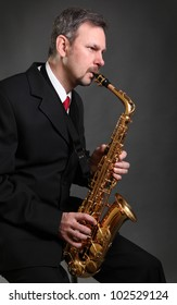 handsome adult man with saxophone