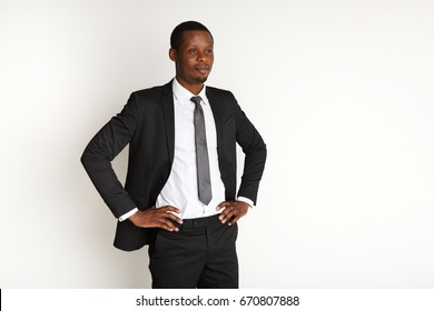 Handsome african american business man posing isolated. Young confident businessman in suit. Success, professional concept