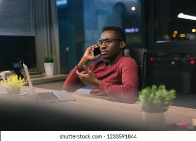 Handsome African American businessman in office working