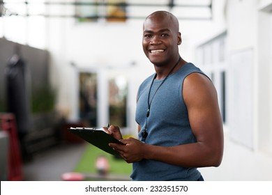 handsome african american male trainer with clipboard