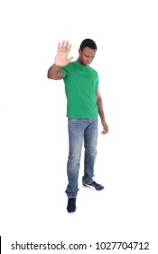 A handsome African American man in a green polo shirt lifting his hand