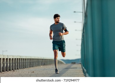 Handsome african american man running outdoors.