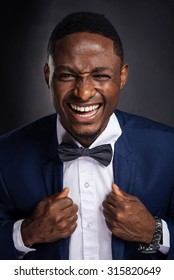 Handsome african american man shouting with positive expression
