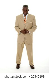 Handsome African American man in a tan business suit with a direct, smiling forward facing expression.