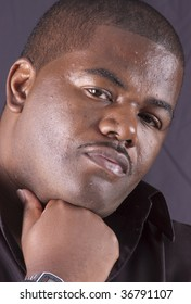Handsome african american man thinking with head rested on hand
