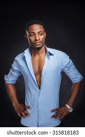 Handsome african american stylish man on black background