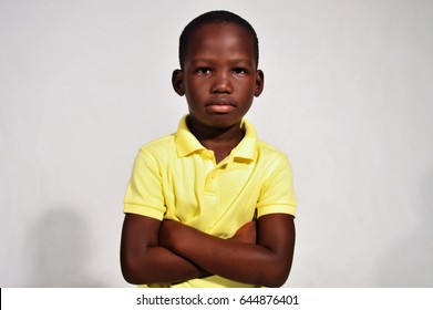 handsome African black boy with arms crossed