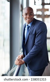 handsome african businessman in modern office